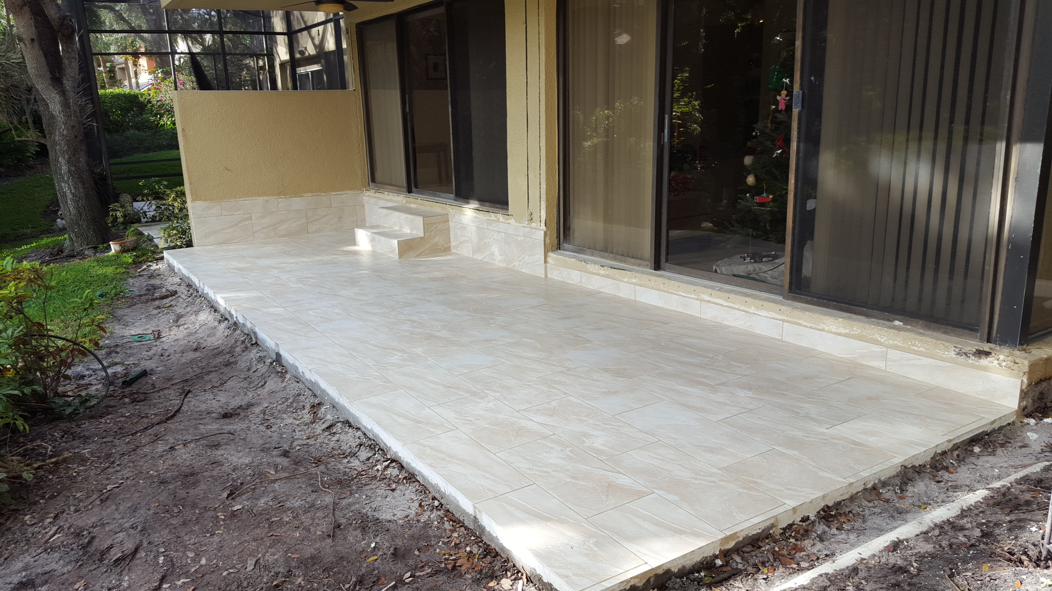 Concrete patio and tiles for Louis B in Boca Raton